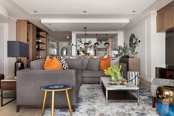 Grey sofa and coffee table in open-plan interior