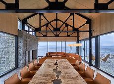 Custom dining table in open-plan interior