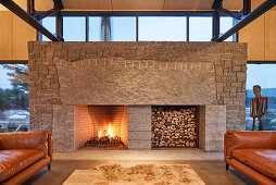 Designer fireplace in open-plan interior
