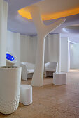 White seating and tree-like sculptures in spa area
