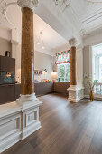 Open-plan kitchen with stucco and pillars in Wilhelmine-era villa