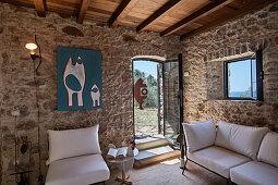 White sofa set in Italian stone house