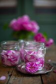 Pink roses in screw-top jars