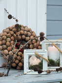 Wreath of walnuts and candle lanterns