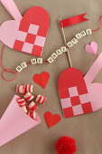 Love note on string of lettered beads and paper love hearts
