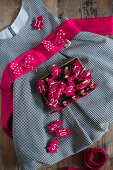 Numbered Christmas trees made from red felt on child's gingham dress