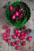 Numbered, red felt Christmas trees in cake tin