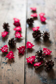 Pine cones and numbered, red felt Christmas trees