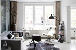 Masculine living room in shades of grey with large windows