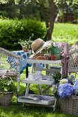 Shabby-chic side table in pleasant seating area in garden