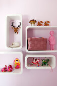 Colourful kitsch accessories in shelving modules with rounded corners