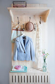 Pale wooden coat stand