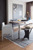 Dining table with designer chair and benches on grey rug