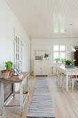 Long runner in a white Scandinavian style dining room