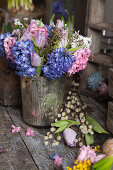 Hyacinths, tulips and Australian waxflowers in silver vase