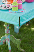 Handmade tablecloth with slit corners and weights