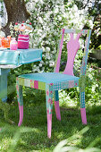 Pale blue and pink chair covered with romantic fabric decoupage