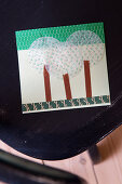 Homemade postcard made of masking tape and muffin liners with a tree motif
