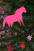 Homemade horse made of pink paper as a Christmas tree decoration