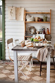 Rustic, country-house table set for Easter breakfast