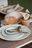 Quail eggs and cord on rustic set table