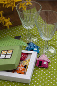 Handsewn, house-shaped drinking glass labels