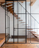 Staircase behind glass wall