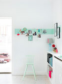 Wall border made of washi tape with photos of children in the living room