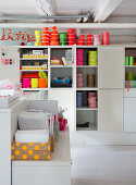 Shelves with fabric borders and sewing accessories in the craft room