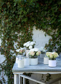 Screw-cap jars with paper cuffs with white roses and chrysanthemums