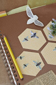 Honeycombs and bees made of paper on a ring binder