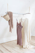 Hanging branch on wooden pearl necklaces as a clothes rail
