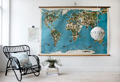 Black rattan chair in front of a vintage style map of the world