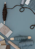 Cord and fabric ribbons in blue-gray and natural tones