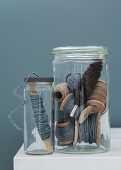 Cords on spools of thread in screw jar and mason jar