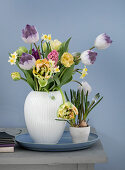 Tulips, hyacinths, daffodils, and grape hyacinths in a vase