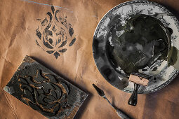 Black ink in a bowl for inking stamps