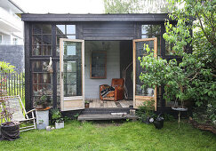 A view into a glass house made from recycled materials