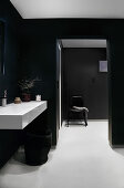 A washbasin in a black-and-white bathroom