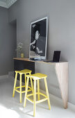 A breakfast bar with yellow bar stools