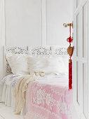 Open coffered door to bedroom with romantic bed