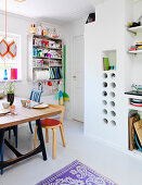 Colourful accessories in a kitchen with a white floor