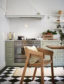 Classic eat-in kitchen with painted floorboard with a checkerboard pattern
