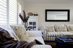 Beige-and-white striped sofa in classic living room