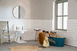 Chipmunk figurines in bathroom of DIY dolls' house