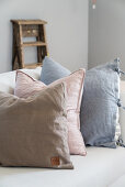 Linen scatter cushions in pastel shades on sofa