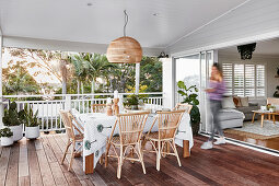 Dining table and rattan chairs on terrace