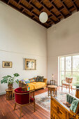 Vintage-style living room with high ceiling and board floor