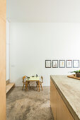 View of toys on child's table and kitchen counter with concrete top