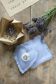 Handmade lavender sachets and lavender flowers in handcrafted paper box